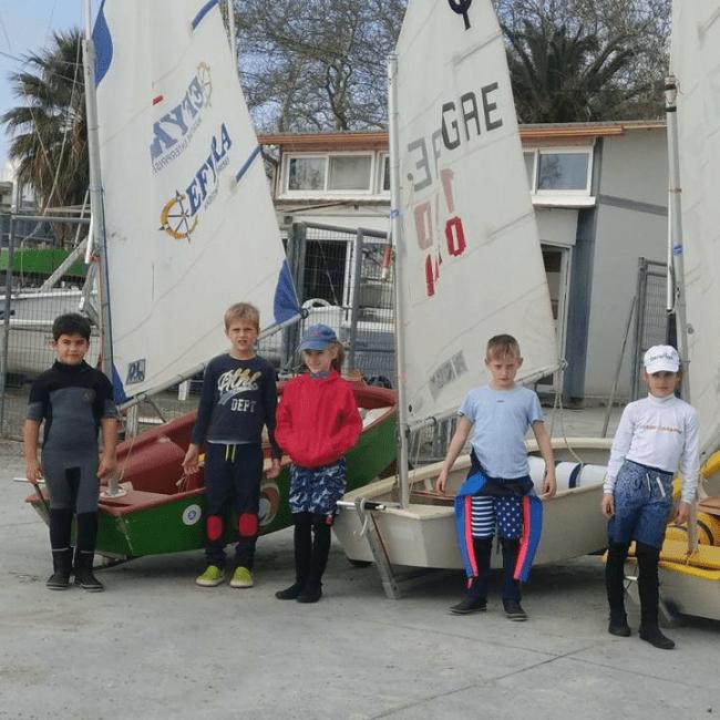 dinghy sailing in Kalamata Group Optimiist