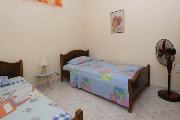 Santova Hill apartment 'Cute' bedroom 2, bed and ventilator