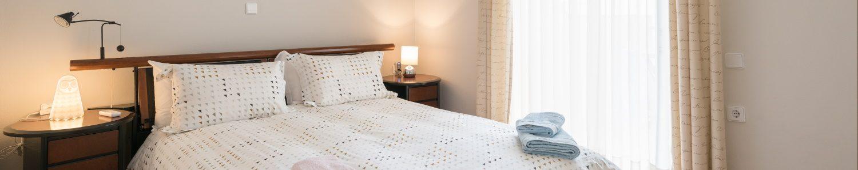 Bed Bedroom 2 in Comfy City Apartment FIL27 1500x300