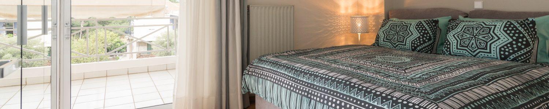 Bed Bedroom 1 in Comfy City Apartment FIL27 1500x300